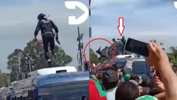 متظاهرون يقذفون شرطيا جزائريا من أعلى سيارة